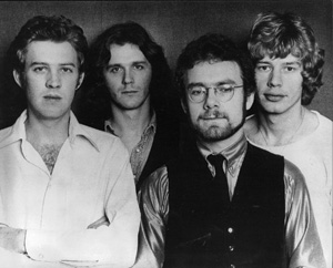 King Crimson 1974, L-to-R: David Cross (who appeared on Red but no longer as an official member), John Wetton, Robert Fripp, Bill Bruford.