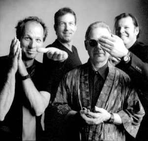 King Crimson 2003, L-to-R: Adrian Belew, Trey Gunn, Robert Fripp, Pat Mastelotto.